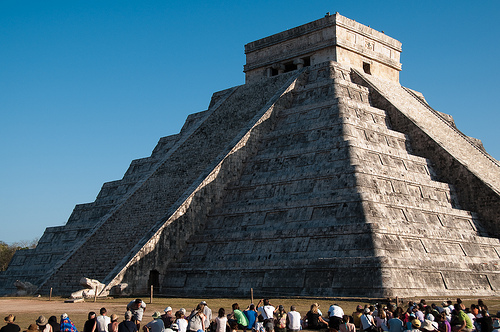 Crowds gather to witness the serpent descend the pyramid