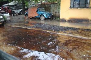 street awash with oil photo