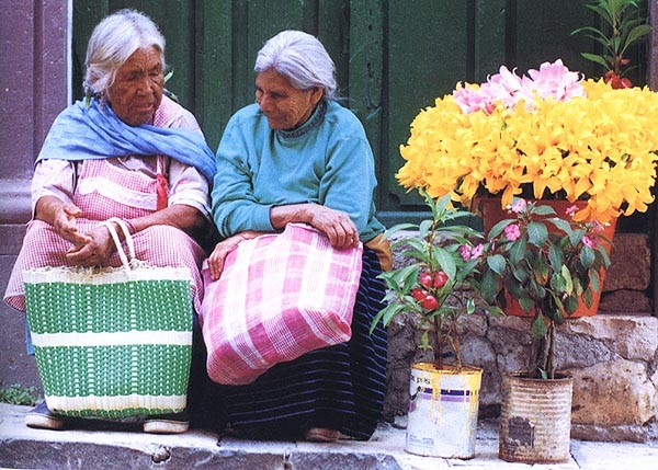 """Two flower vendors"". Photographer: Ned Brown"